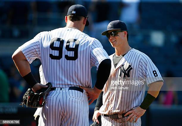 Aaron Judge and Tyler Austin of the New York Yankees are interviewed after a game against the Tampa Bay Rays at Yankee Stadium on August 13 2016 in...