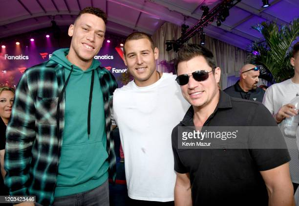 Aaron Judge Anthony Rizzo and Nick Lachey attend Michael Rubin's Fanatics Super Bowl Party at Loews Miami Beach Hotel on February 01 2020 in Miami...