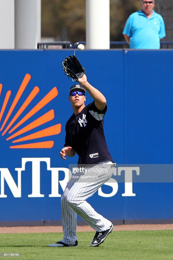 Aaron Judge (99) catches a fly ball during the New York Yankees spring training workout on February 20, 2018, at George M. Steinbrenner Field in Tampa, FL.