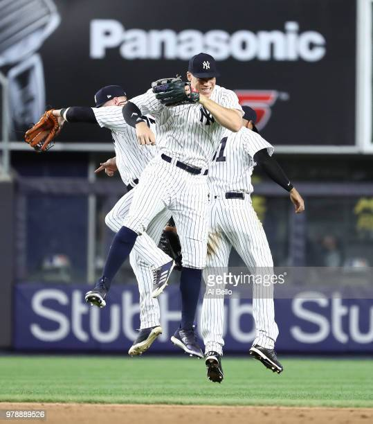 Aaron Judge Clint Frazier and Aaron Hicks of the New York Yankees celebrate a 72 win against the Seattle Mariners during their game at Yankee Stadium...