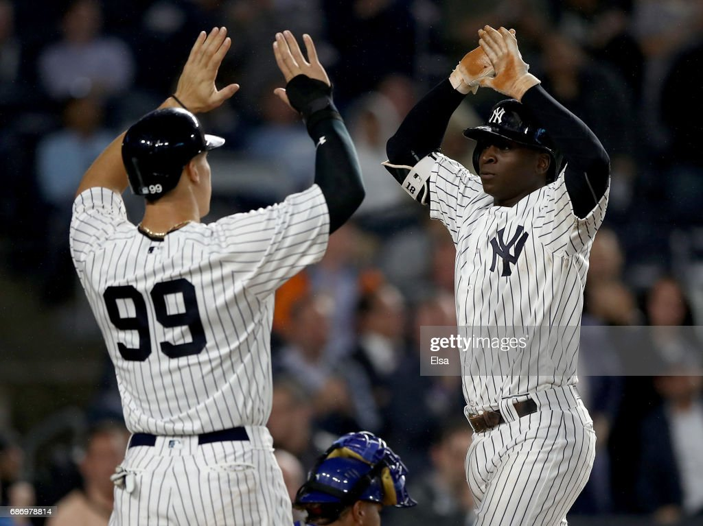 Aaron Judge #99 congratulates teammate Didi Gregorius #18 of the New York Yankees after Gregorius drove them both in with a two run home run in the fourth inning against the Kansas City Royals on May 22, 2017 at Yankee Stadium in the Bronx borough of New York City.