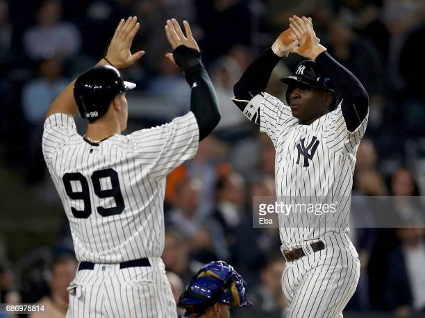 Aaron Judge congratulates teammate Didi Gregorius of the New York Yankees after Gregorius drove them both in with a two run home run in the fourth...