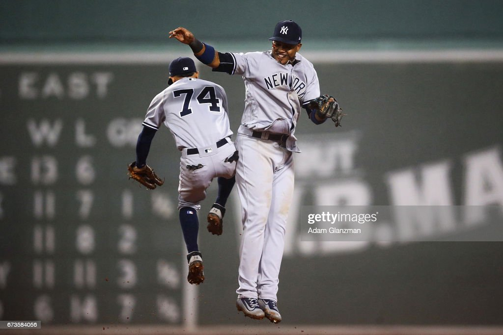 Aaron Judge #99 high fives Ronald Torreyes #74 of the New York Yankees after their victory over the Boston Red Sox at Fenway Park on April 26, 2017 in Boston, Massachusetts.