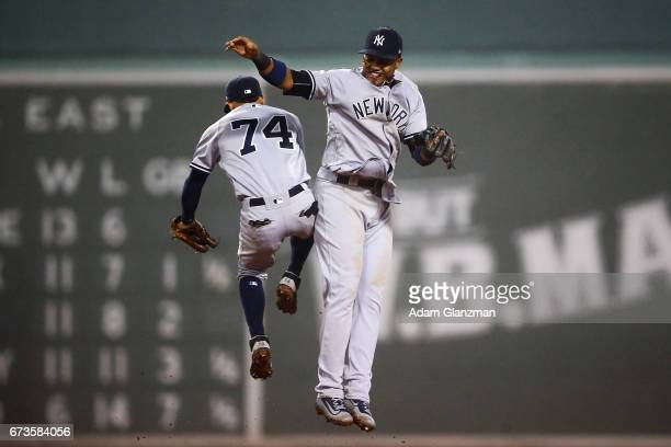 Aaron Judge high fives Ronald Torreyes of the New York Yankees after their victory over the Boston Red Sox at Fenway Park on April 26 2017 in Boston...