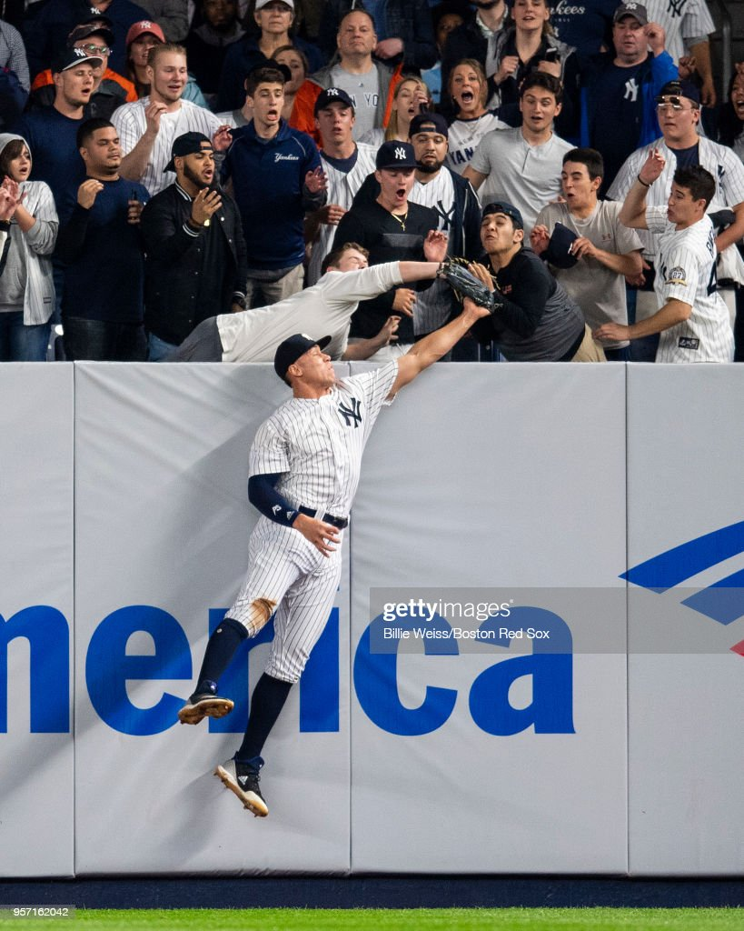 Aaron Judge #99 leaps at the wall but can't come up with the ball off the bat of J.D. Martinez of the Boston Red Sox for the go-ahead run in the eighth inning of a game on May 10, 2018 at Yankee Stadium in the Bronx borough of New York City.