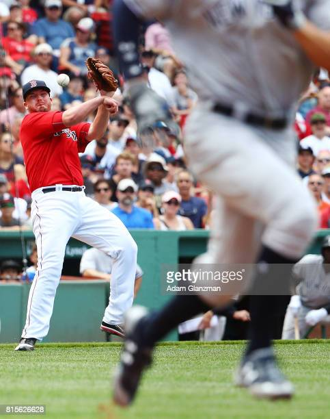 Aaron Judge of the New York runs to first base as Austin Maddox of the Boston Red Sox throws to first in the seventh inning during game one of a...