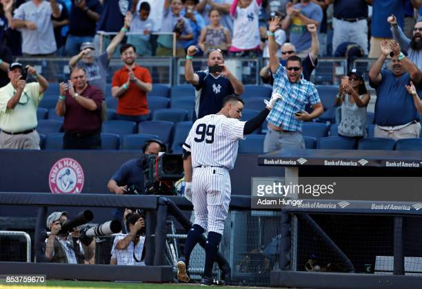 Aaron Judge of the New York Yankees acknowledges a curtain call after hitting a solo home run against the Kansas City Royals during the seventh...