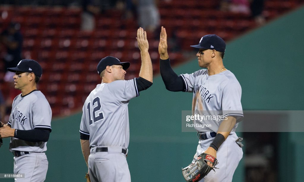 Aaron Judge #99 of the New York Yankees and teammate Chase Headley #12 celebrate a victory against the Boston Red Sox at Fenway Park on July 15, 2017 in Boston, Massachusetts. The Yankees won 4-1 in sixteen innings.