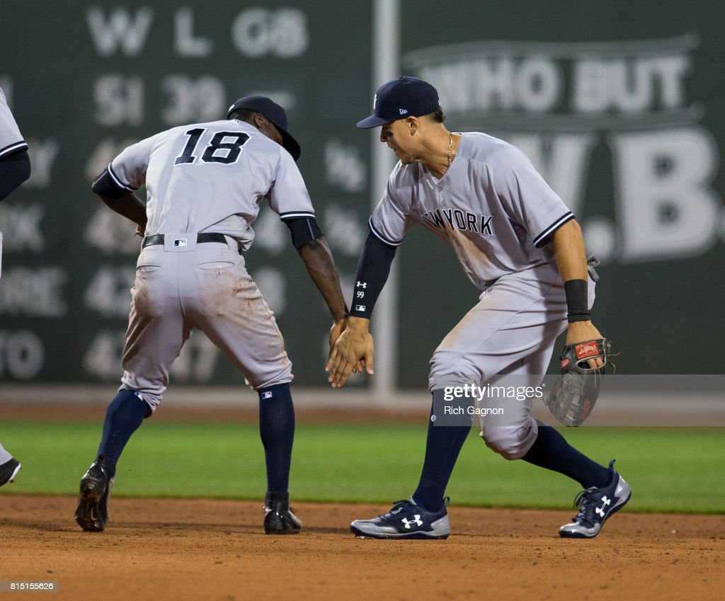 Aaron Judge #99 of the New York Yankees and teammate Didi Gregorious #18 celebrate a victory against the Boston Red Sox at Fenway Park on July 15, 2017 in Boston, Massachusetts. The Yankees won 4-1 in sixteen innings.