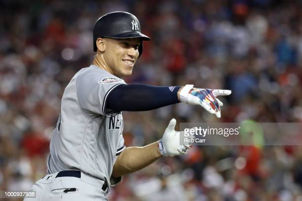 Aaron Judge of the New York Yankees and the American League celebrates after hitting a solo home run in the second inning against the National League...