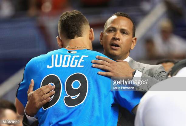 Aaron Judge of the New York Yankees and the American League greets former MLB player Alex Rodriguez during batting practice for the 88th MLB AllStar...