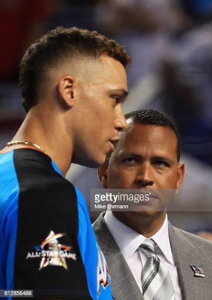 Aaron Judge of the New York Yankees and the American League talks with former MLB player Alex Rodriguez during batting practice for the 88th MLB...