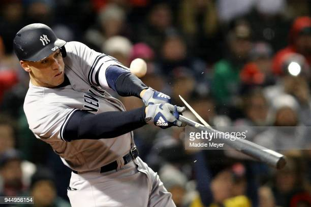 Aaron Judge of the New York Yankees breaks his bat during the fourth inning against the Boston Red Sox at Fenway Park on April 11 2018 in Boston...