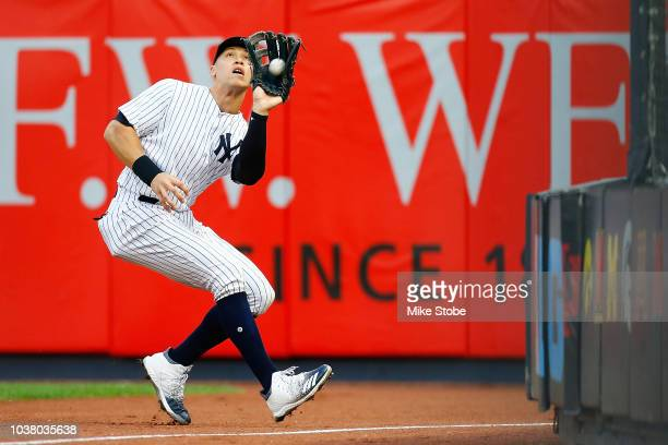 Aaron Judge of the New York Yankees catches a fly ball off the bat of Caleb Joseph of the Baltimore Orioles in the sixth inning at Yankee Stadium on...
