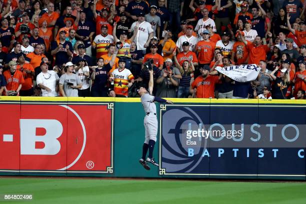Aaron Judge of the New York Yankees catches a line drive in the outfield hit by Yuli Gurriel of the Houston Astros during the second inning in Game...