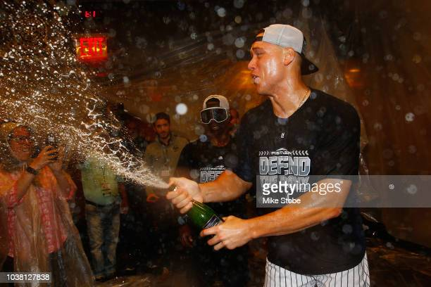 Aaron Judge of the New York Yankees celebrates after clinching a playoff spot after defeating the Baltimore Orioles 32 in eleventh inning at Yankee...