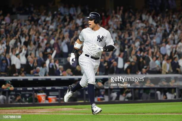 Aaron Judge of the New York Yankees celebrates after hitting a home run during the American League Wild Card game against the Oakland Athletics at...