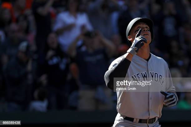 Aaron Judge of the New York Yankees celebrates after hitting a home run against the Baltimore Orioles during the eighth inning at Oriole Park at...