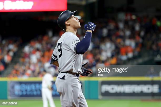 Aaron Judge of the New York Yankees celebrates after hitting a solo home run against Brad Peacock of the Houston Astros during the eighth inning in...