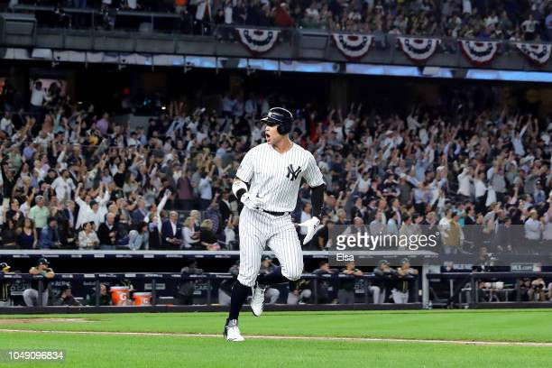 Aaron Judge of the New York Yankees celebrates after hitting a two run home run against Liam Hendriks of the Oakland Athletics during the first...