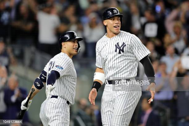 Aaron Judge of the New York Yankees celebrates after scoring a run off of a double hit by Aaron Hicks during the sixth inning against the Oakland...