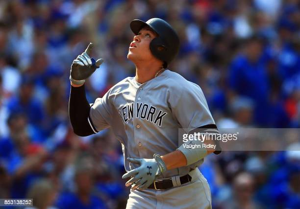 Aaron Judge of the New York Yankees celebrates his 2nd home run of the game in the seventh inning during MLB game action against the Toronto Blue...