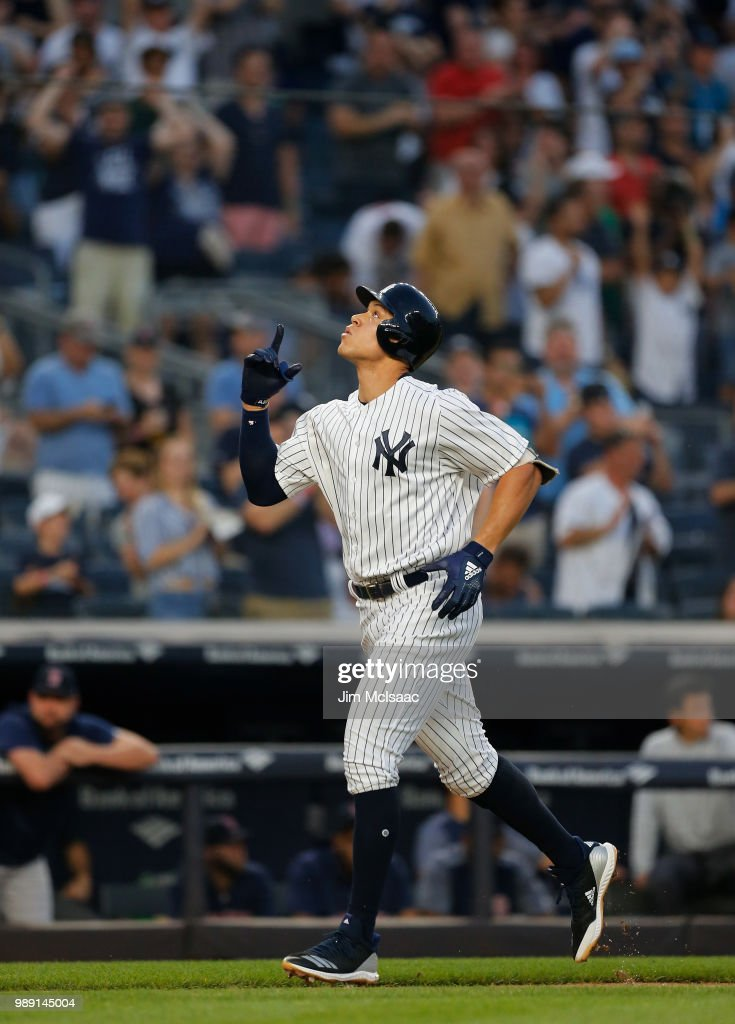 Aaron Judge #99 of the New York Yankees celebrates his first inning home run against the Boston Red Sox as he runs the bases at Yankee Stadium on July 1, 2018 in the Bronx borough of New York City.