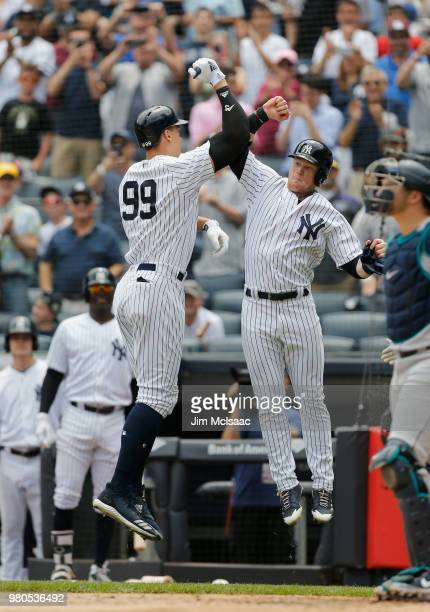 Aaron Judge of the New York Yankees celebrates his first inning two run home run against the Seattle Mariners with teammate Clint Frazier at Yankee...