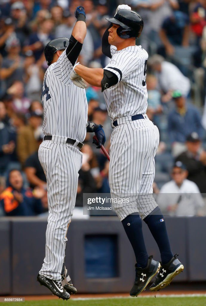Aaron Judge #99 of the New York Yankees celebrates his fourth inning home run against the Toronto Blue Jays with teammate Gary Sanchez #24 at Yankee Stadium on September 30, 2017 in the Bronx borough of New York City.
