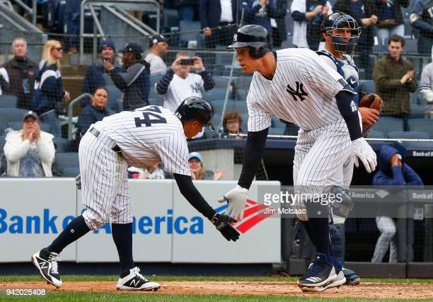 Aaron Judge of the New York Yankees celebrates his fourth inning two run home run against the Tampa Bay Rays with teammate Ronald Torreyes at Yankee...