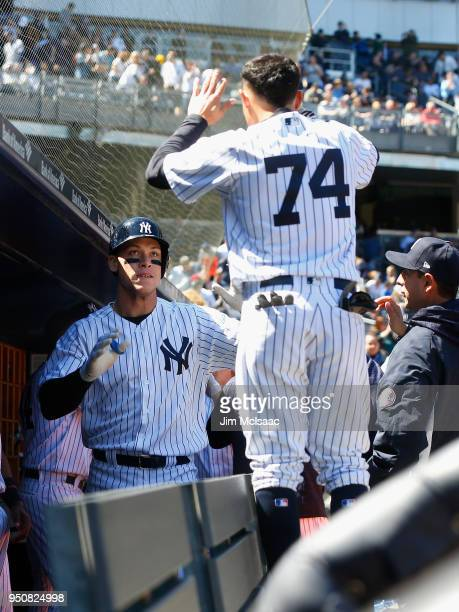 Aaron Judge of the New York Yankees celebrates his home run against the Toronto Blue Jays with teammate Ronald Torreyes at Yankee Stadium on April 21...
