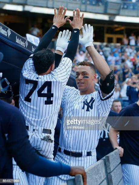 Aaron Judge of the New York Yankees celebrates his seventh inning home run against the Kansas City Royals with teammate Ronald Torreyes at Yankee...