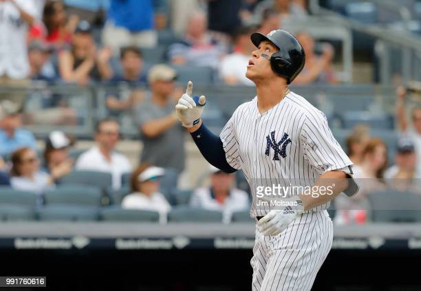 Aaron Judge of the New York Yankees celebrates his seventh inning home run against the Atlanta Braves at Yankee Stadium on July 4 2018 in the Bronx...