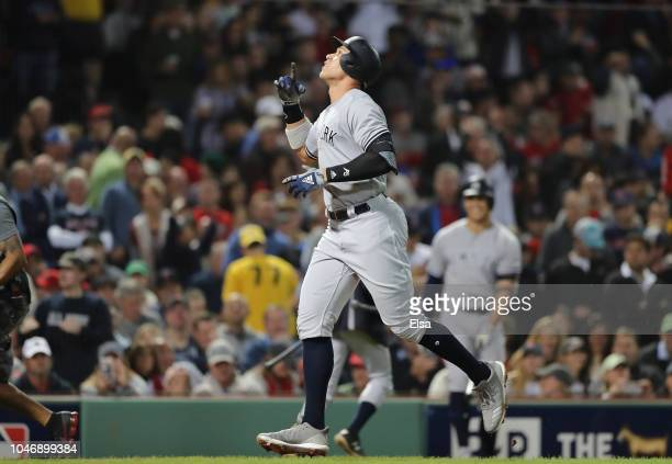 Aaron Judge of the New York Yankees celebrates his solo home run as he crosses home plate during the first inning of Game Two of the American League...