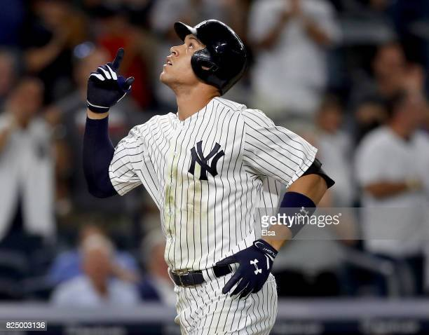 Aaron Judge of the New York Yankees celebrates his solo home run in the fifth inning against the Detroit Tigers on July 31 2017 at Yankee Stadium in...