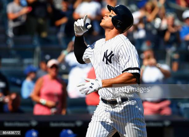 Aaron Judge of the New York Yankees celebrates his third inning home run against the Kansas City Royals at Yankee Stadium on September 25 2017 in the...