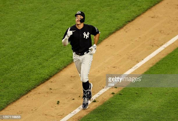 Aaron Judge of the New York Yankees celebrates his two run home run in the sixth inning against the New York Mets during Summer Camp play at Yankee...