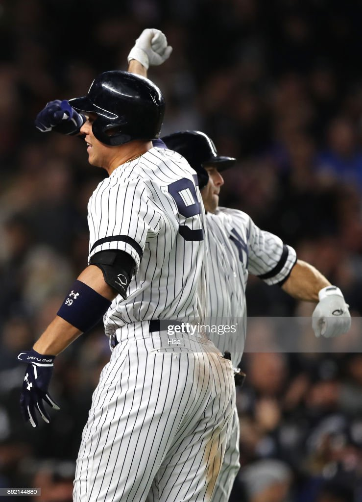 Aaron Judge #99 of the New York Yankees celebrates hitting a 3-run home run against the Houston Astros during the fourth inning with teammate Brett Gardner #11 in Game Three of the American League Championship Series at Yankee Stadium on October 16, 2017 in the Bronx borough of New York City.