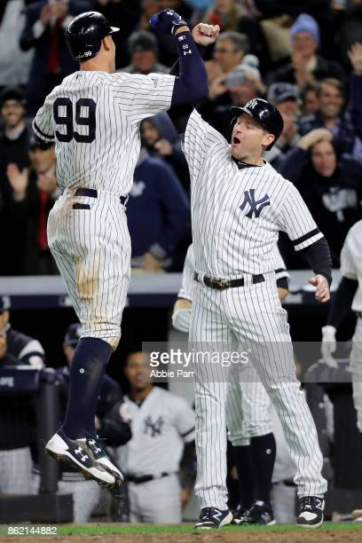 Aaron Judge of the New York Yankees celebrates hitting a 3run home run against the Houston Astros during the fourth inning with teammate Chase...