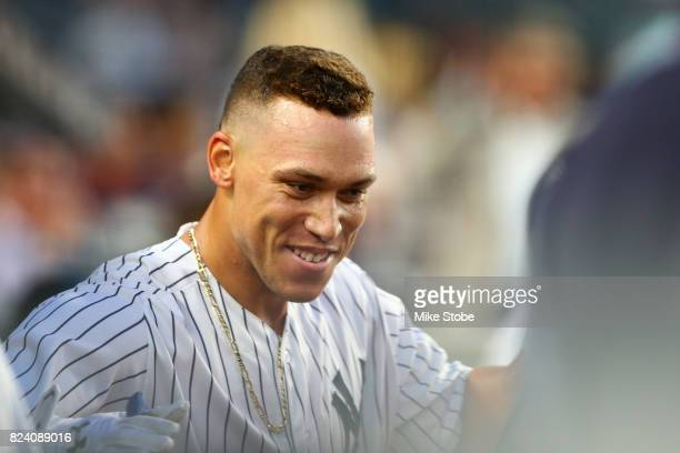 Aaron Judge of the New York Yankees celebrates in the dugout after hitting a solo home run in the fourth inning against the Tampa Bay Rays at Yankee...