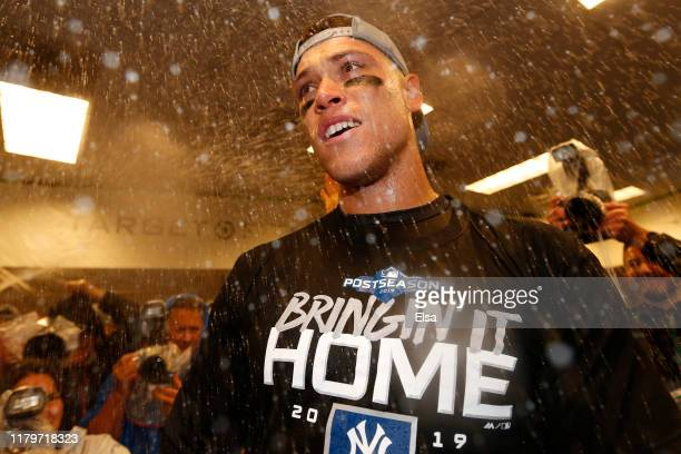 Aaron Judge of the New York Yankees celebrates in the locker room after sweeping the Minnesota Twins 3-0 in the American League Division Series to...