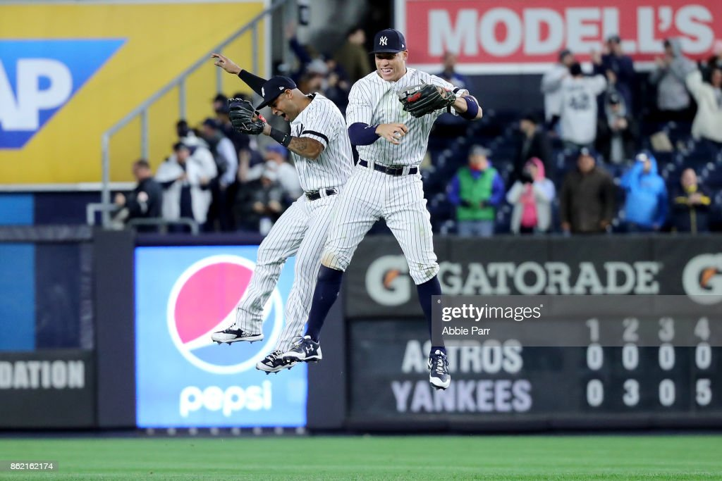 Aaron Judge #99 of the New York Yankees celebrates with Aaron Hicks #31 after defeating the Houston Astros in Game Three of the American League Championship Series at Yankee Stadium on October 16, 2017 in the Bronx borough of New York City. The New York Yankees defeated the Houston Astros 8-1.