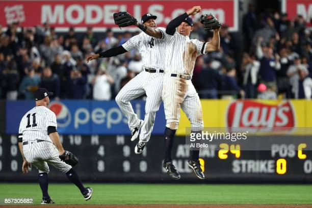 Aaron Judge of the New York Yankees celebrates with Aaron Hicks and Brett Gardner after defeating the Minnesota Twins in the American League Wild...