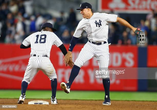 Aaron Judge of the New York Yankees celebrates with Didi Gregorius after defeating the Boston Red Sox 32 at Yankee Stadium on May 8 2018 in the Bronx...