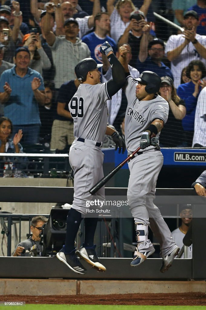Aaron Judge #99 of the New York Yankees celebrates with Gary Sanchez #24 after he hit a home run against the New York Mets during the eighth inning of a game at Citi Field on June 9, 2018 in the Flushing neighborhood of the Queens borough of New York City.
