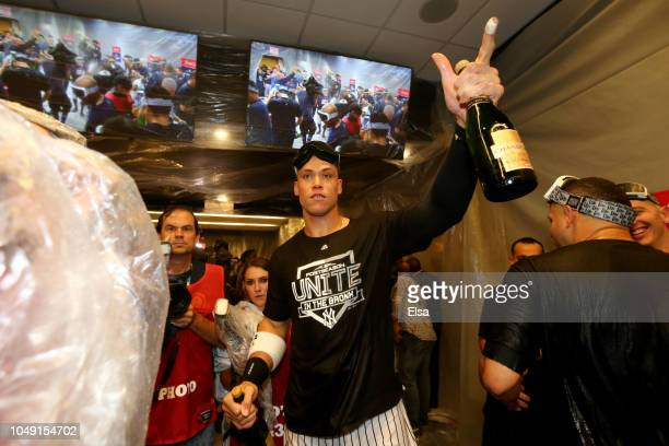 Aaron Judge of the New York Yankees celebrates with his teammates after winning the American League Wild Card Game against the Oakland Athletics at...