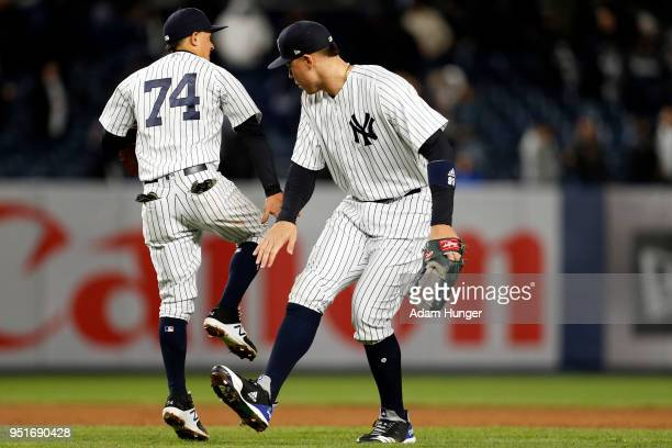 Aaron Judge of the New York Yankees celebrates with Ronald Torreyes of the New York Yankees after defeating the Toronto Blue Jays at Yankee Stadium...