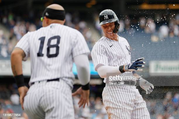 Aaron Judge of the New York Yankees celebrates with Rougned Odor after being walked by Liam Hendriks of the Chicago White Sox allowing teammate Clint...
