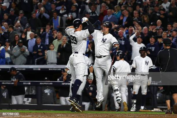 Aaron Judge of the New York Yankees celebrates with teammate Gary Sanchez after hitting a two run home run against Jose Berrios of the Minnesota...