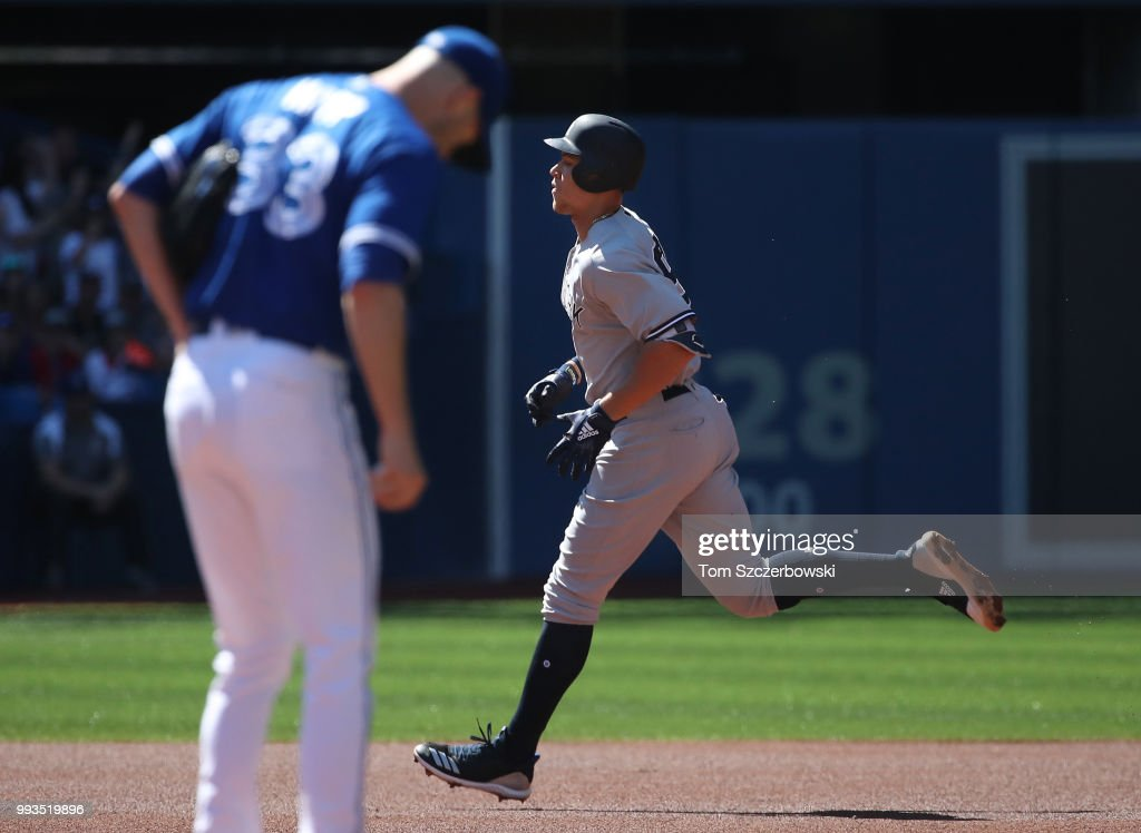 Aaron Judge #99 of the New York Yankees circles the bases after hitting a solo home run in the first inning during MLB game action as J.A. Happ #33 of the Toronto Blue Jays reacts at Rogers Centre on July 7, 2018 in Toronto, Canada.